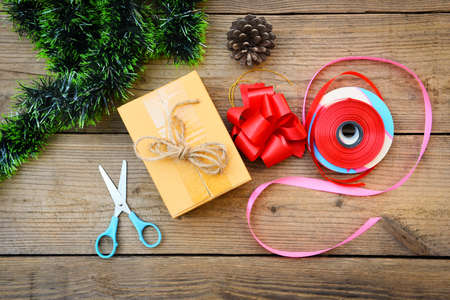 diy gift concept / Homemade wrapped christmas presents with tools and decorations on wooden , DIY hobby gift box wrapped brown paper collection in for christmas or new year