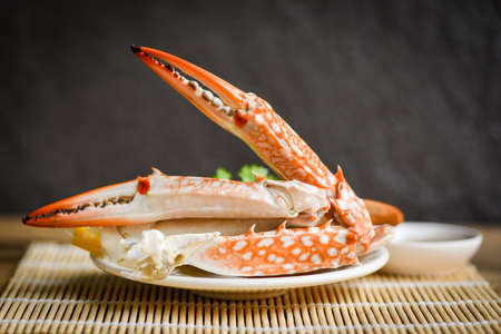 Boiled crab food on white plate and seafood sauce on the table / crab claws shellfish Zdjęcie Seryjne