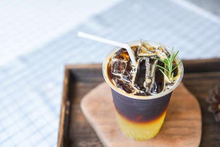 black coffee mix Orange syrup sparkling and rosemary / Iced americano Iced coffee with lemon orange juice and soda Zdjęcie Seryjne