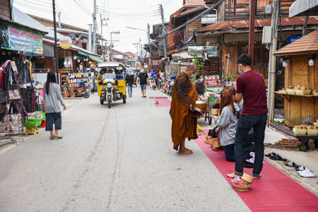 Chiang Khan Loei Thailand - 13 September 2020 : tourists at Chiang Khan walking Street in ancient community local travel and shopping in holiday
