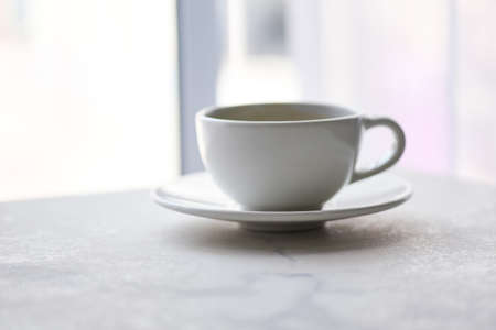 coffee cup on desk / black coffee in white mug on the table