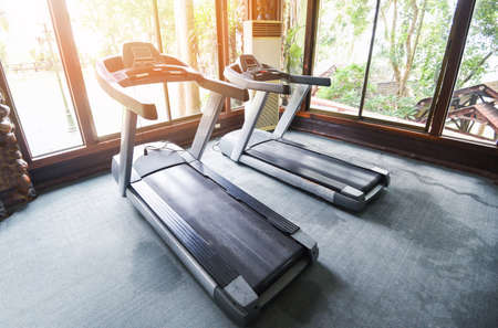 Fitness gym with Treadmills running machine / Sports equipment in gym for exercise , fitness club