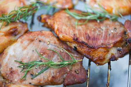 grilled pork meat with sauce and herbs and spices cooking thai asian food rosemary pork on chopping board