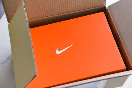 Nike running shoes box with nike logo on orange box in the store : Bangkok Thailand November 4, 2020 Editorial