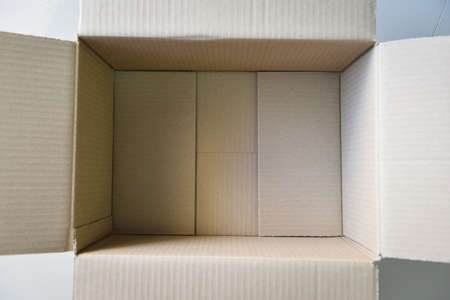Open cardboard box on floor background, High angle view of an empty cardboard box or Parcel box 版權商用圖片