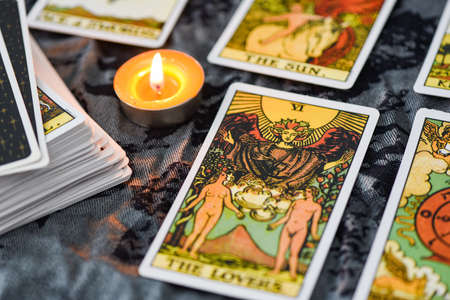 Tarot cards by candlelight on dark background fortune card prophecy, gypsy card for fortune teller reading future : Bangkok Thailand October 30 , 2020