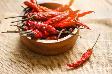 Dried chili on bowl / Red dried chilli pepper cayenne on sack background 版權商用圖片