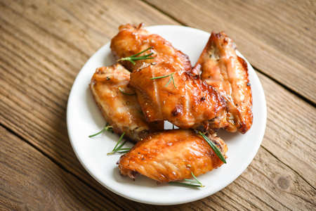 Baked chicken wings with sauce herbs and spices cooking thai asian food rosemary chicken grilled