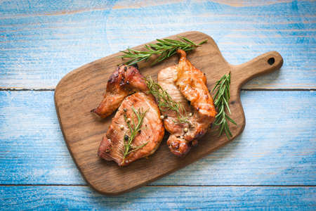 grilled pork meat with sauce and herbs and spices cooking asian food rosemary pork on chopping board