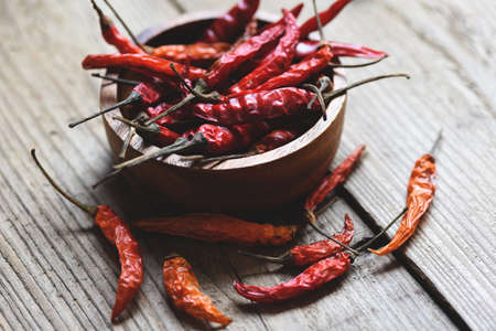 Dried chili on bowl / Red dried chilli pepper cayenne on a wooden background