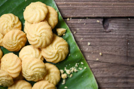 breakfast cookies vanilla on banana leaf and wooden background, mini cookies biscuits
