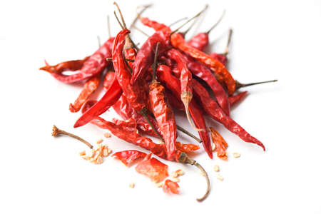 Dried chili on white background / pile of red dried chilli pepper cayenne