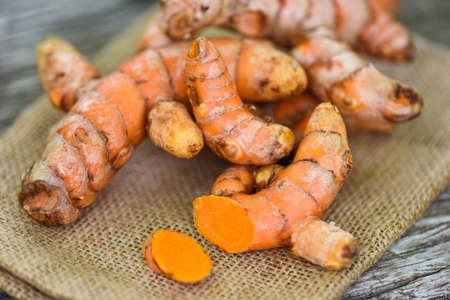 turmeric on the sack, fresh turmeric root for nature medicine herb and cooked ingredient food