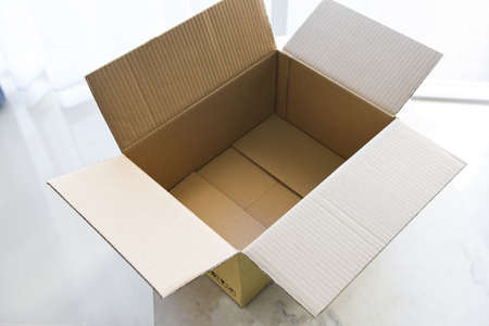 Open cardboard box on floor background, High angle view of an empty cardboard box or Parcel box