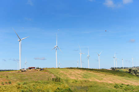 wind turbine landscape natural energy green Eco power concept at wind turbines farm blue sky background