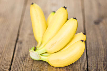 ripe banana tropical fruit on wooden background, fresh banana 写真素材