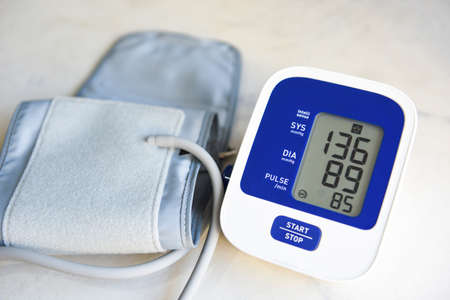 Blood Pressure Monitor Digital on table , Medical electronic tonometer check blood pressure and heart rate Health and Medical concept