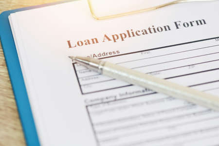 Loan application form, Financial loan money contract agreement company credit or person with a pen filling in information