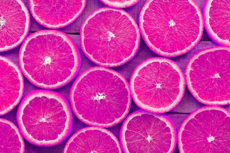Orange slices texture background, Fresh orange fruits orange pattern on wooden background - top view Imagens