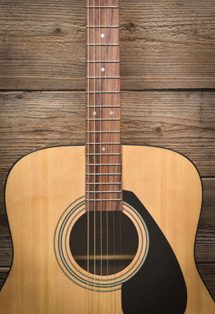 Home hobbies, Guitar resting on old wooden background, Close up acoustic guitar - top view Musical instrument for recreation or hobby passion concept.