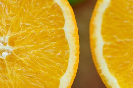 Orange slice healthy fruits concept, Close up orange fruits on wooden background