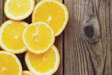 Fresh orange fruits slices on wooden background, Orange peel