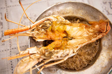 Casseroled prawns with vermicelli in brown clay pot , Baked Shrimp with Glass Noodles