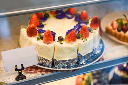 Cake on shelf with cake strawberry and blueberry on store bakery shop