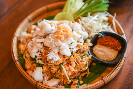 Fried noodle shrimp prawn and crab meat, Thai food noodles stir fry vegetables and rice vermicelli with egg cooked Asian food 写真素材