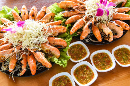 Grilled shrimp prawn with fresh vegetable and seafood sauce,  shrimps grilled serve on tray - seafood buffet Thai food 写真素材