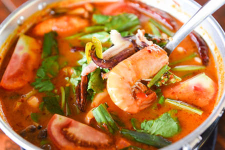 Prawn soup, Spicy soup with shrimp seafood coconut milk and chili pepper in pot, Hot and sour curry shrimps and squid Thai food Asian 写真素材