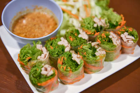 Fresh spring rolls with vegetable and pork homemade with peanut sauce - Thai food