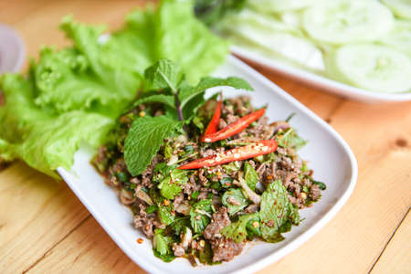 Spicy Minced Pork Salad with fresh vegetable, Beef meat Salad Thai food