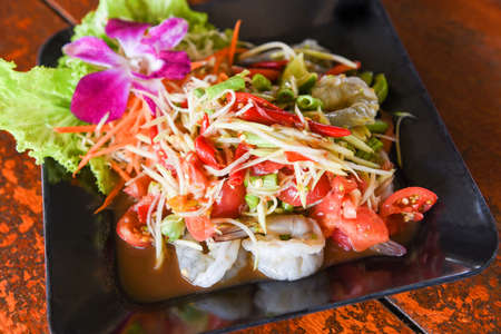 Green papaya salad with shrimp prawn Thai food, spicy salad herbs Reklamní fotografie