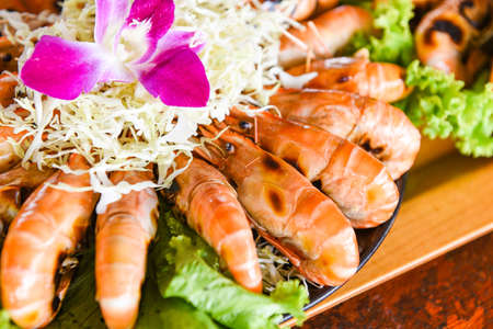 Seafood buffet Thai food, Grilled shrimp prawn with fresh vegetable and seafood sauce shrimps grilled serve on tray