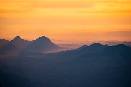 Landscape sunrise or sunset on the mountain beautiful sky yellow orange, Mountain valley during sunrise natural summer landscape Reklamní fotografie