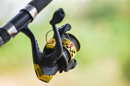 Fishing reel on Fishing rod, Fishing on the feeder with nature background