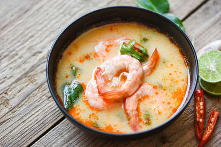 Traditional thai cuisine hot spicy soup shrimp curry with herb and spices Thai food, Shrimp soup bowl, seafood soup with shrimps prawns in the restaurant