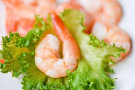 Salad shrimp seafood shelfish, fresh shrimps prawns on vegetable lettuce healthy food