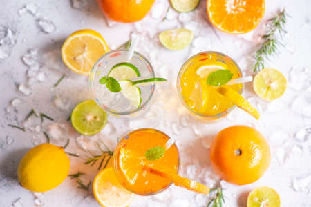 Colorful summer drink juicy, Exotic summer drinks refreshing variety of cold drinks glasses fresh fruit on ice homemade cocktail tea with mojito lemon lime orange rosemary and mint leaf