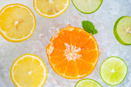 Summer drinks refreshing of cold drinks fresh fruit on ice bucket homemade cocktail tea with mojito lemon lime orange slice, summer drink juicy