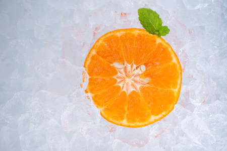 Summer refreshing of cold drinks fresh fruit orange slice on ice with mint leaf, top view