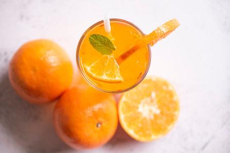 Summer drink juicy orange slice, Exotic summer drinks refreshing of cold drinks glasses fresh fruit on ice homemade cocktail tea with orange and mint leaf Zdjęcie Seryjne
