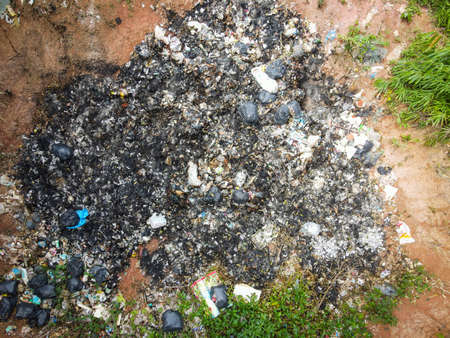 Aerial view landfill garbage waste huge dump environmental pollution problem, Top view on plastic and other industrial waste ecological disaster from above with incinerate garbage burn global warming Zdjęcie Seryjne
