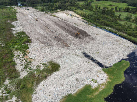 Aerial view landfill garbage waste huge dump environmental pollution problem, Top view on plastic and other industrial waste ecological disaster from above garbage global warming and area waste water Zdjęcie Seryjne