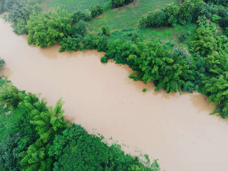 Aerial view river flood forest nature woodland area green tree, Top view river lagoon pond with water flood from above, Bird eye view landscape jungles lake flowing wild water after the rain Stockfoto