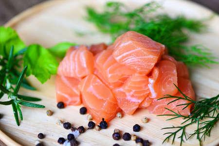 Fresh salmon fish for cooking salad seafood japanese food, Wasabi sauce raw salmon filet on wooden Stockfoto