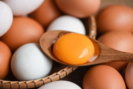 Chicken eggs and duck eggs collect from farm products natural in a basket healthy eating concept, Fresh broken egg yolk Zdjęcie Seryjne