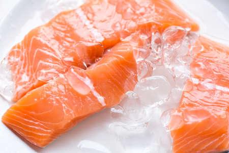 Fresh salmon fish on ice, Close up raw salmon filet seafood for sashimi Zdjęcie Seryjne