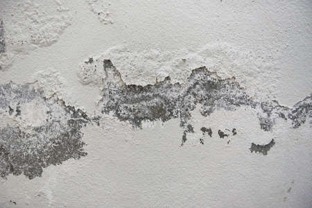Empty old wall texture background, Painted distressed wall surface, Grunge shabby building facade with damaged plaster, cracked color caused by moisture peeling wall